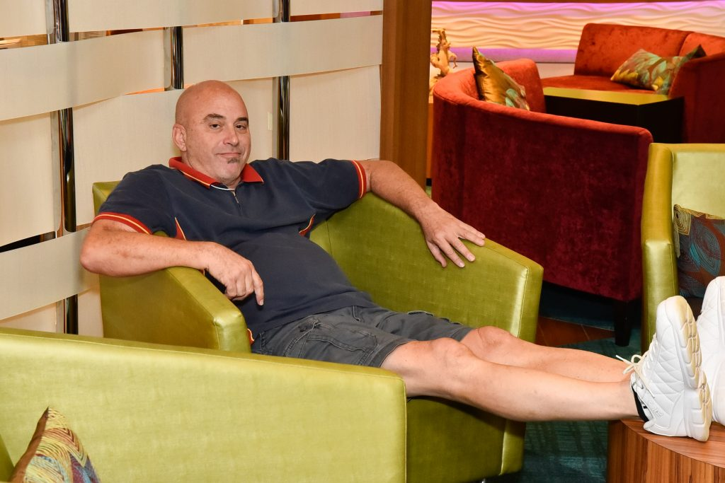 a man lounging with his feet up